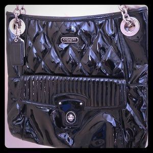 Patent leather black coach bag. Never used.